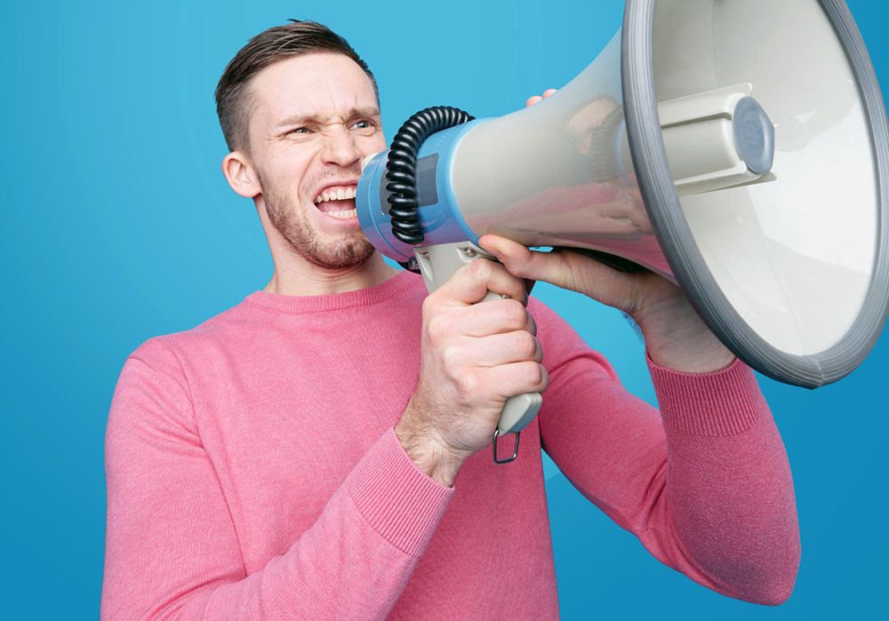 A man yelling into a megaphone.