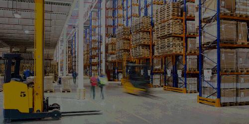 People walking through a warehouse.