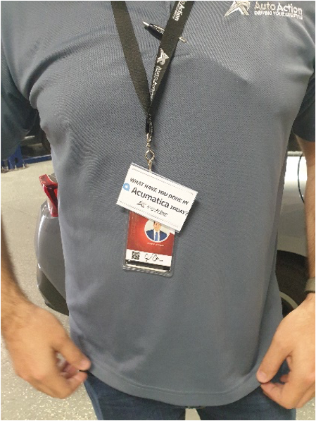 A man at an event with an Acumatica badge.