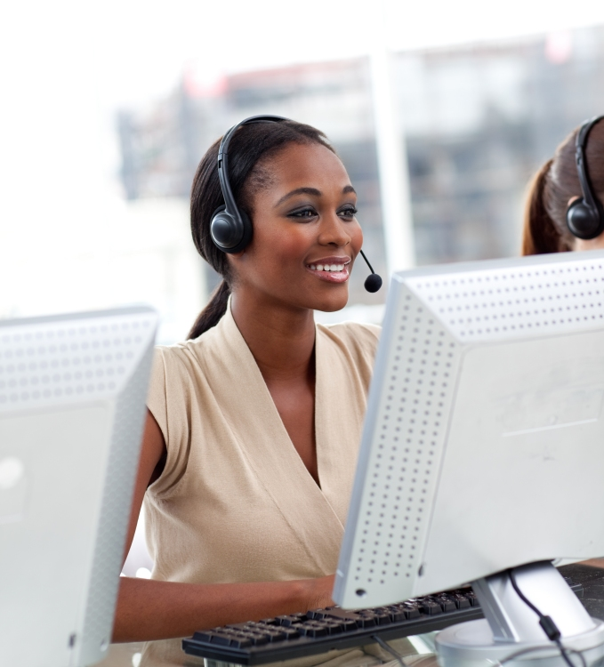 Woman smiling as she works at customer support.