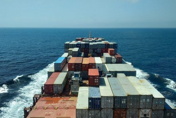 Barge filled with shipping containers.